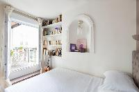 chic master bedroom brushed with calmer hues with access to the terracee in Paris luxury apartment