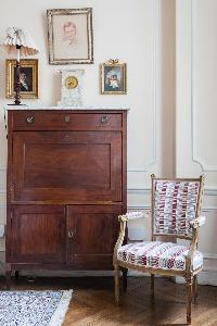 Louis XVI chair and antique cabinet drawer in Paris luxury apartment