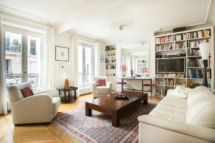 open-plan sitting and dining area with its white-painted with three wide windowand in Paris luxury a
