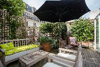a decked terrace with sitting area in Paris luxury apartmenta decked terrace with sitting area in Pa