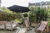a decked terrace with sitting area in Paris luxury apartment
