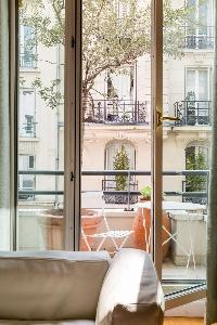 balcony with coffee table in Paris luxury apartment