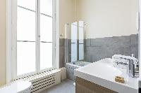 sleek white-and-gray bath in Paris luxury apartment