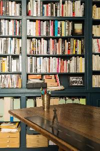 library of books in Paris luxury apartment