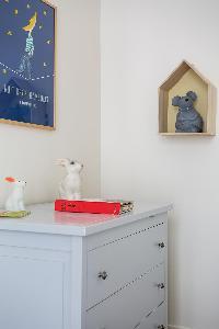 gray cabinet drawer beneath framed artwork in Paris luxury apartment