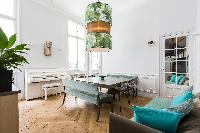 crisp and contemporary dining area with striking square dining table for a centrepiece beneath a sty