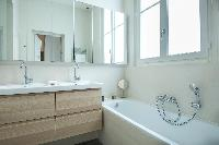 en suite bath with integrated shower in Paris luxury apartment