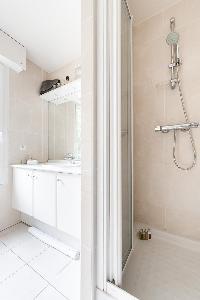 sleek shower area in Paris luxury apartment