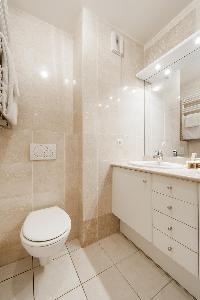 pale-tiled toilet in Paris luxury apartment