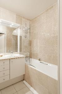 pale-tiled bath in Paris luxury apartment