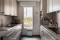 smartly fitted kitchen in Paris luxury apartment