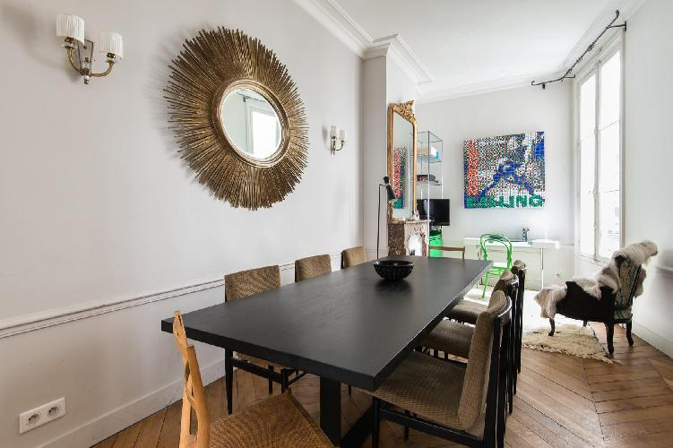 elegant dining room with eye-catching accessories, surrounds a dining table and a little desk in Par