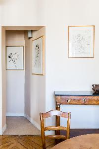 passageway leads past a toilet room and a bathroom in Paris luxury apartment