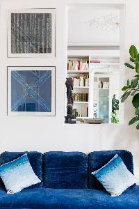 vibrant blue sofa in Paris luxury apartment