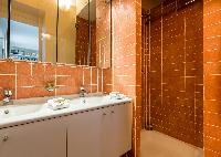 shower area with double sink in Paris luxury apartment