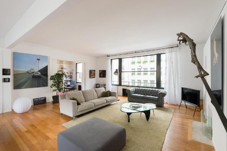 contemporary 4-bedroom Paris luxury apartment with gray and cream sofas