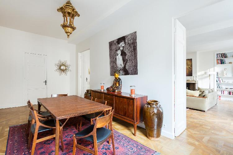 classic dining room with retro table and oriental accessories in Paris luxury apartment