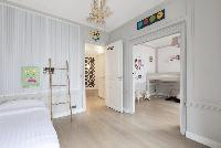 pristine pillows and bed sheets in Paris - Rue Scheffer luxury apartment