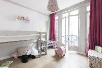 cool kids' bedroom with balcony at Paris - Rue Scheffer luxury apartment