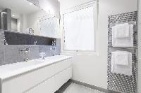 cool double-sink bathroom vanity in Paris - Rue Scheffer luxury apartment