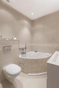 elegant bathroom with tub in Paris - Rue Scheffer luxury apartment