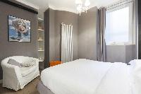 clean and crisp bedroom linens in Paris - Rue Scheffer luxury apartment