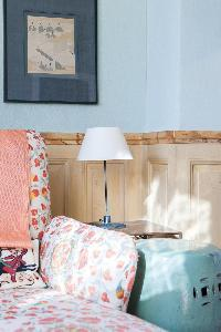 blossoming printed sofa chair in Paris luxury apartment