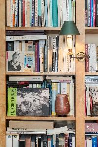 shelf-filled with books in Paris luxury apartment