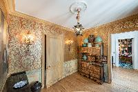 golden printed wall paper and antique pieces in Paris luxury apartment