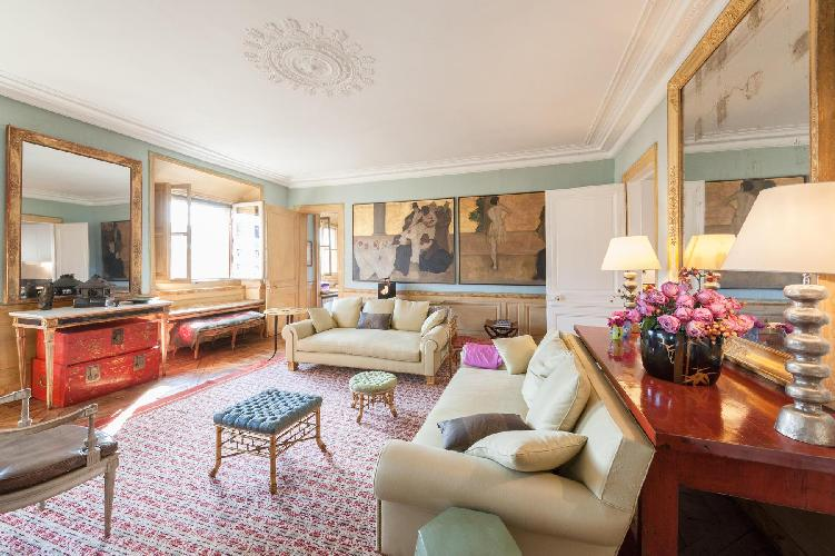 elegant living room with antique artworks lined the walls in Paris luxury apartment
