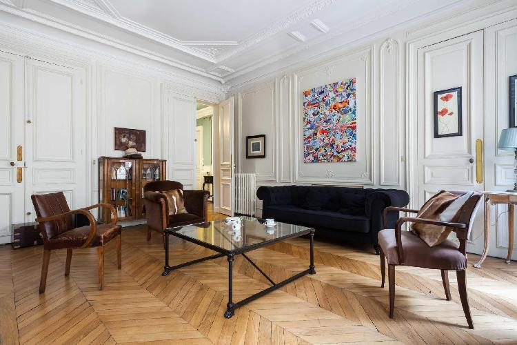 impressive 4-bedroom luxury apartment features vaulted Haussmann ceilings, elegant parquet floors, m