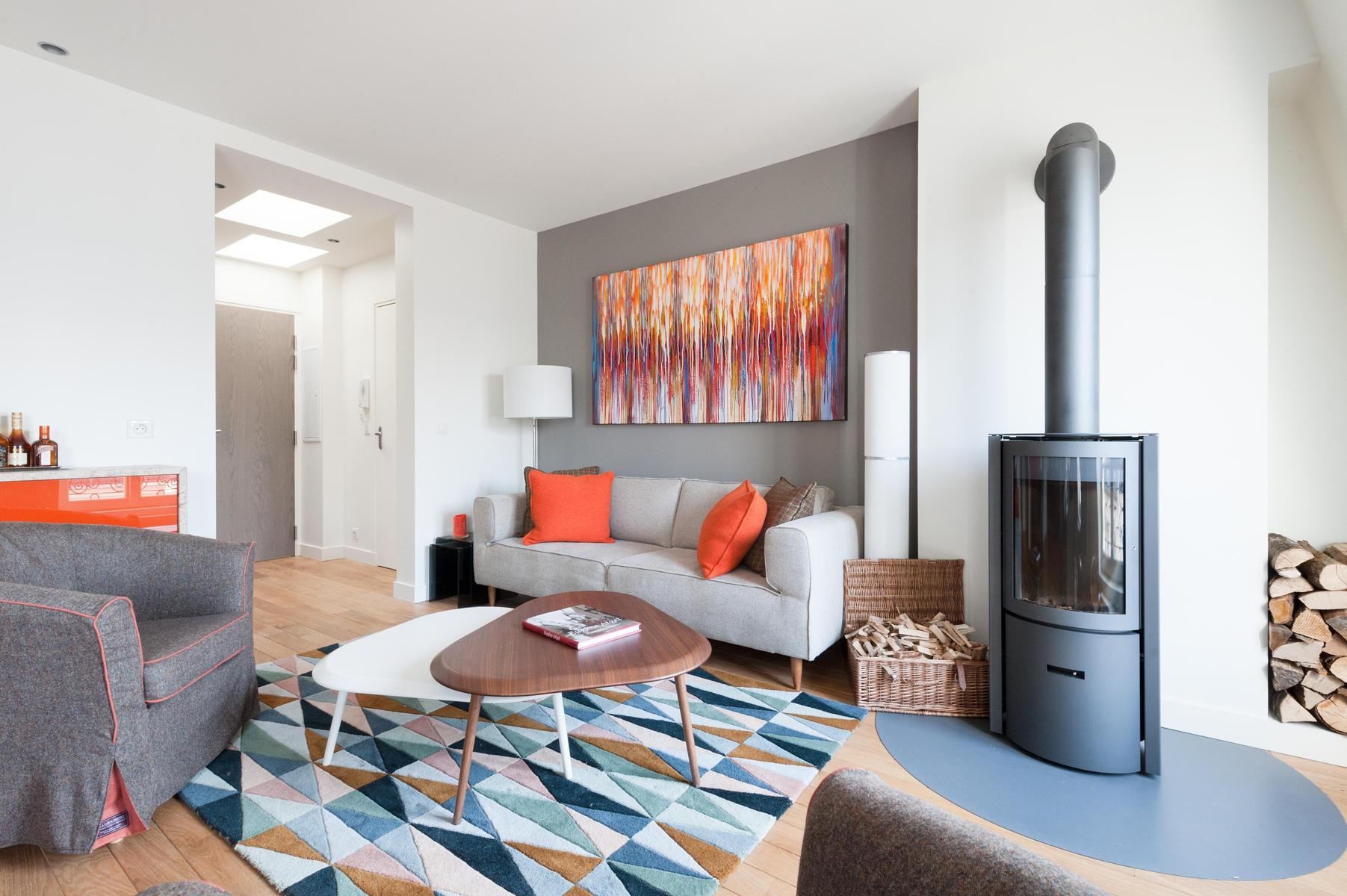 an ornamental wood burner dominates one corner of the living room fuses fifties shapes with Scandi s