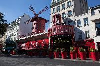 Moulin Rouge near a Paris luxury apartment