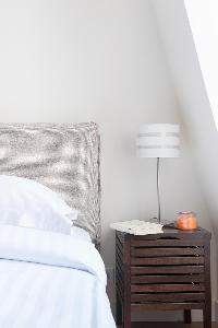 neutral bedroom with the slightest hint of taupe colouring of a creamy palette in Paris luxury apart