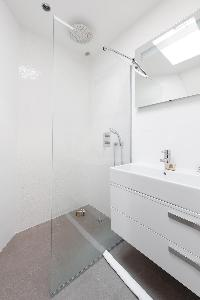 sleek shower area in a creamy palette in Paris luxury apartment