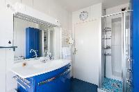 cerulean bathroom in Paris luxury apartment