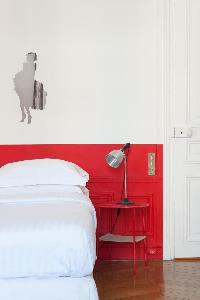 scarlet-and-white walled bedroom in Paris luxury apartment
