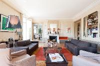 living area with high-ceiling, brightly coloured furnishings, an antique toy rocking horse, modern a