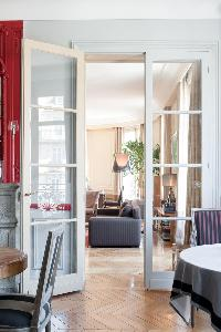 French door opens up to the living area in Paris luxury apartment