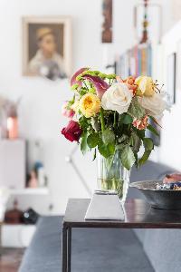 colorful roses in flower vase in Paris luxury apartment