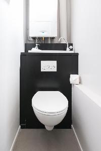 sleek gray-and-white toilet in Paris luxury apartment