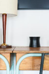 honeyed wood furniture and lamp on top in Paris luxury apartment