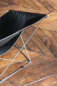 stylish black chair sits on parquet floor in Paris luxury apartment