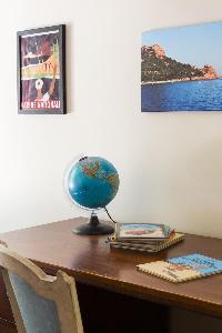 intriguing collection of furniture and artworks - globes and seascapes in Paris luxury apartment