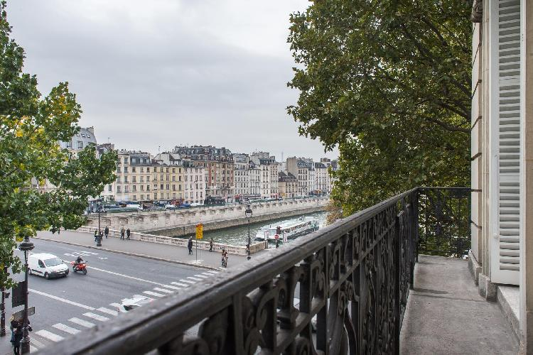 3-bedroom Paris luxury apartment with an amazing view of the local square and the River Seine from t