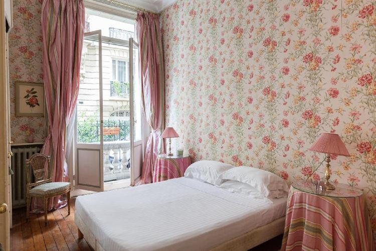 pretty bedroom with a balcony at Paris - Rue Scheffer II luxury apartment