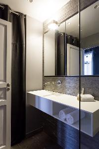 sleek gray-tiled bathroom in Paris luxury apartment