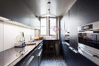 sleek gray kitchen in Paris luxury apartment