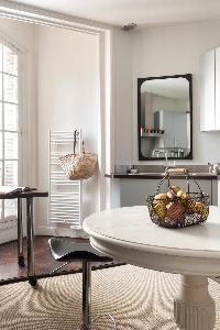 kitchen counter and stools in a 4-bedroom Paris luxury apartment