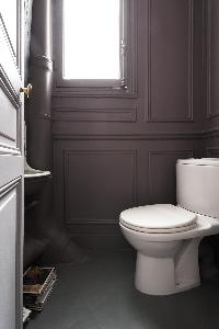 a toilet in a 4-bedroom Paris luxury apartment